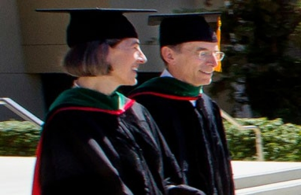 Laurie Weisberg walks into the commencement ceremony.