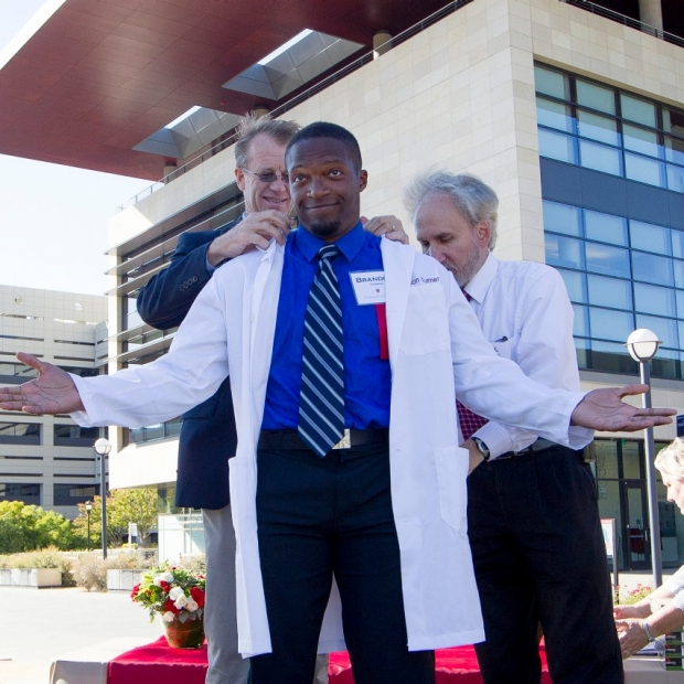 Equipped with stethoscopes, medical students start journey