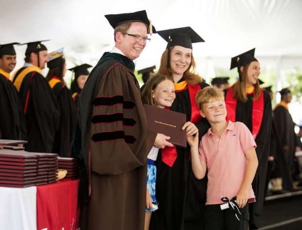 Dean Minor with graduate and her two children