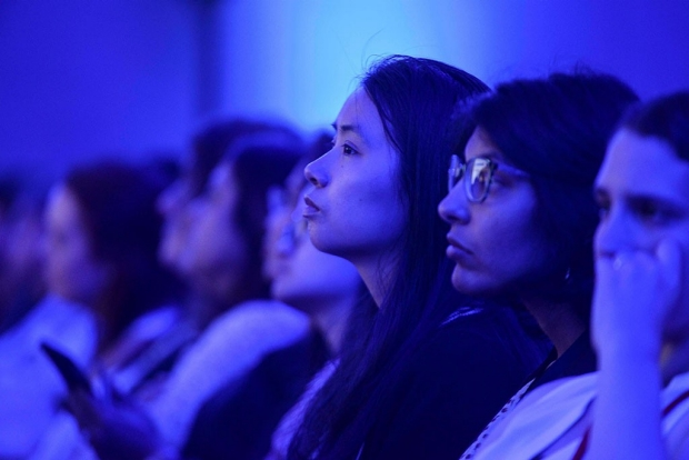 Audience members listening to a lecture
