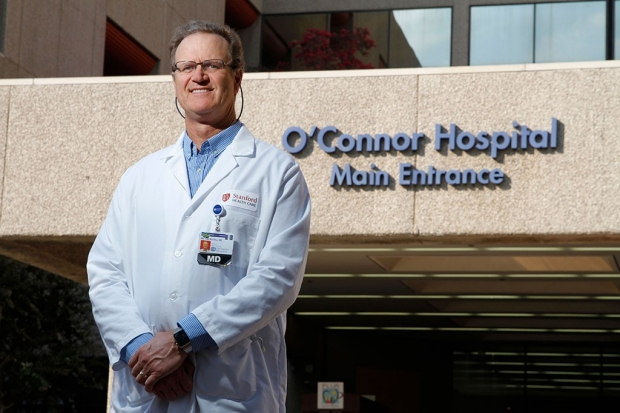 Doctor standing in front of O'Connor Hospital