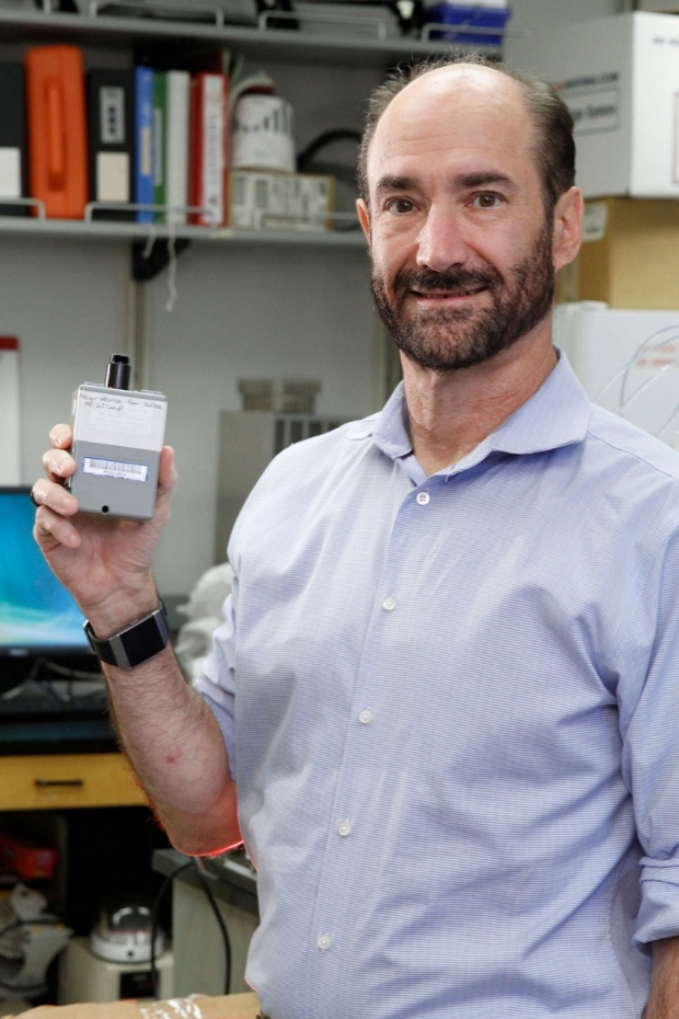 Michael Snyder holding an environmental monitor
