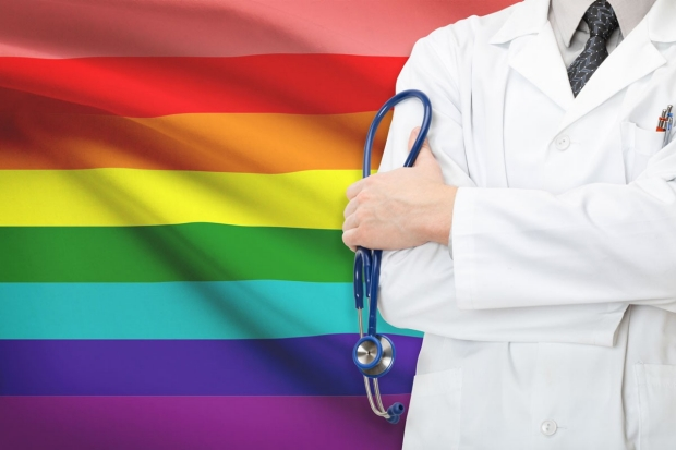 rainbow flag and physician with stethoscope