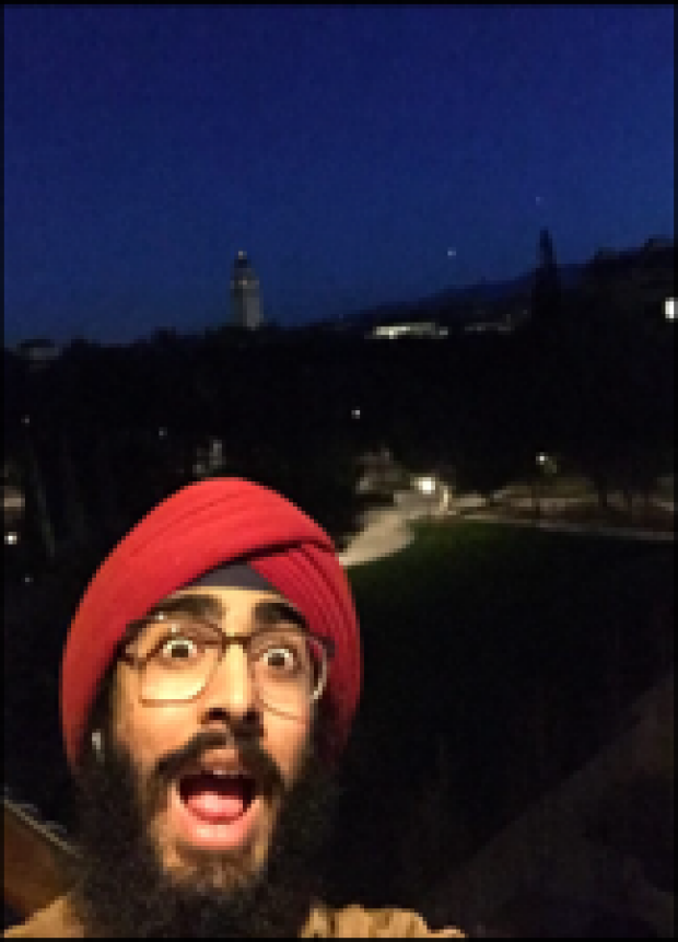 Stoked-Graduate-JJ-Kapur-does-a-well-being-challenge-high-up-in-McMurty-building-atop-Stanford-University